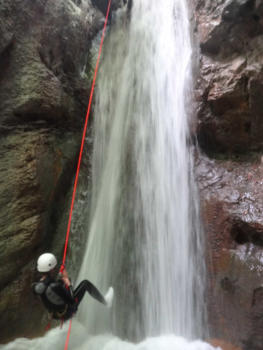 Abseiling a waterfall in Pissarde canyon, Near Grenoble and Lyon, Vercors range
