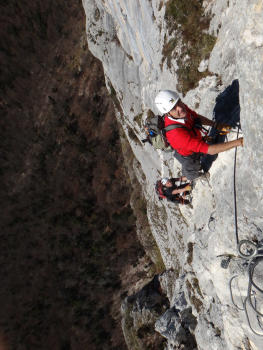 Vertical climbing in the second part of roche veyrand via ferrata