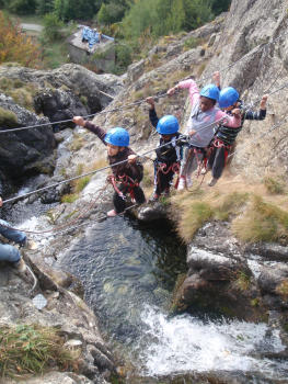Many beams and monkey bridges in the Waterfall via ferrata