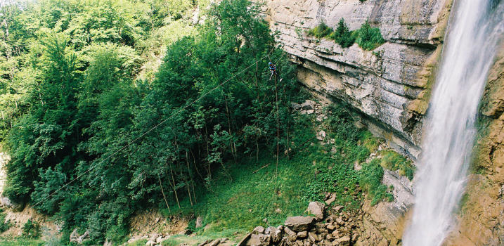 Zip line at the end of Ecouges upper part, Vercors range, near Lyon and Grenoble